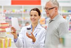 pharmacist shows the medicine to the customer